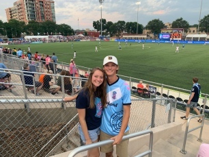 Gretchen and Peyton at a Forward Madison FC soccer game