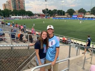 Gretchen and Peyton at a Forward Madison FC soccer game